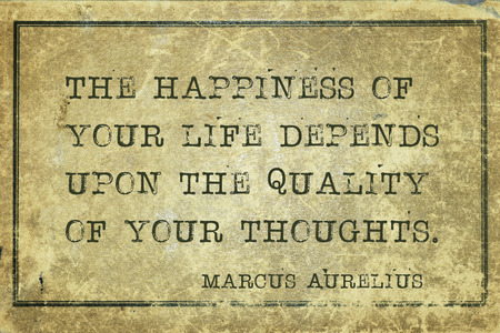 ancient philosophy: The happiness of your life depends upon - ancient Roman philosopher Marcus Aurelius quote printed on grunge vintage cardboard