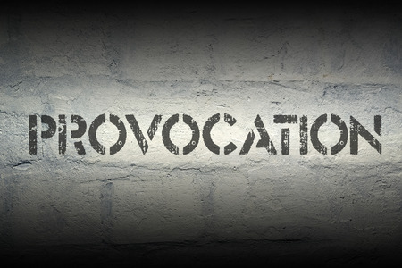 provocation: provocation stencil print on the grunge white brick wall Stock Photo