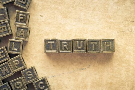 blocks: truth word made from metallic blocks over grunge paper background Stock Photo
