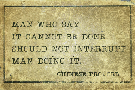 proverb: Man who say it cannot be done should not interrupt man doing it - ancient Chinese proverb printed on grunge vintage cardboard