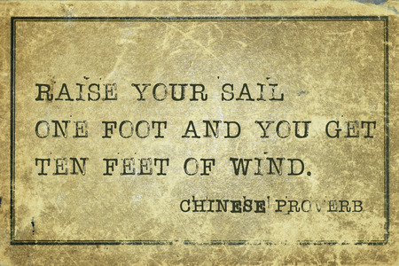proverb: Raise your sail one foot and you get ten feet of wind - ancient Chinese proverb printed on grunge vintage cardboard