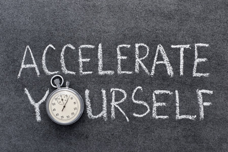 accelerate: accelerate yourself phrase handwritten on chalkboard with vintage precise stopwatch used instead of O