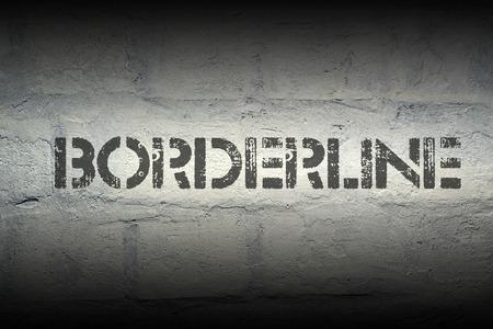 borderline: borderline stencil print on the grunge white brick wall