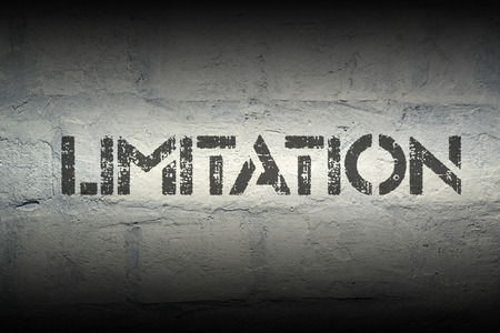 limitation: limitation stencil print on the grunge white brick wall