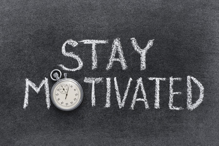 stay motivated phrase handwritten on chalkboard with vintage precise stopwatch used instead of O Stockfoto