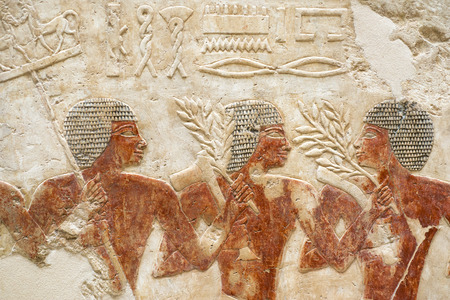 ancient: ancient Egypt stone relief with three human figures