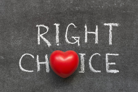 the right choice: right choice phrase handwritten on blackboard with heart symbol instead of O Stock Photo