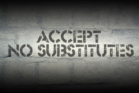 surrogate: accept no substitutes stencil print on the grunge white brick wall