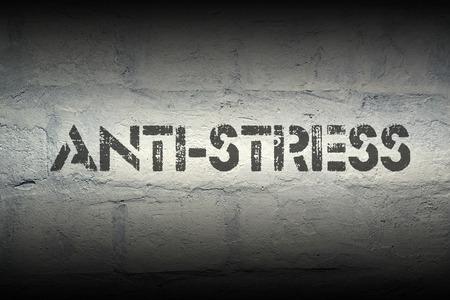 thrilling: anti-stress stencil print on the grunge white brick wall
