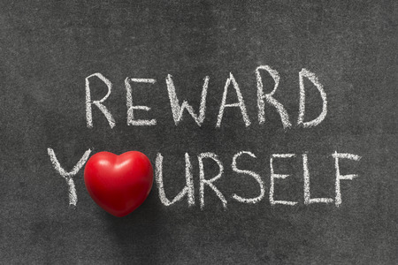 reward yourself phrase handwritten on blackboard with heart symbol instead of O Stock Photo - 40001763