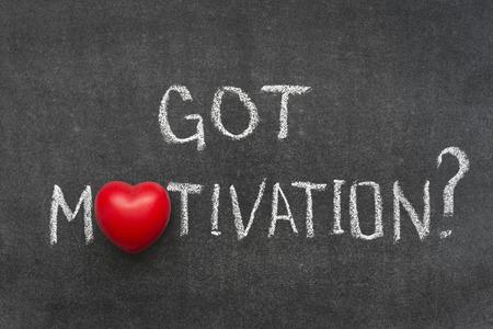necessity: got motivation question handwritten on blackboard with heart symbol instead of O Stock Photo