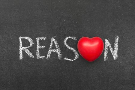 necessity: reason word handwritten on blackboard with heart symbol instead of O
