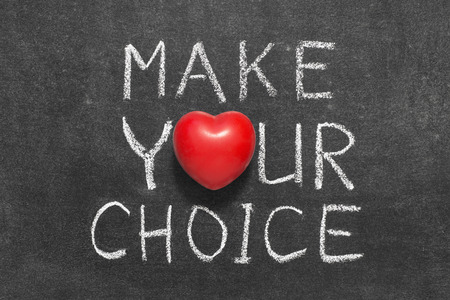 make a choice: make your choice phrase handwritten on blackboard with heart symbol instead of O Stock Photo