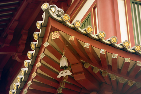 buddhist temple roof: fragment of Buddhist wooden temple roof with hanged bell