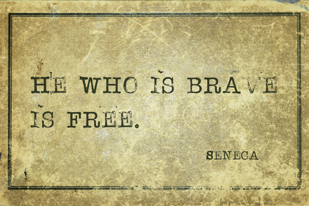 seneca: He who is brave is free ancient Roman philosopher Seneca quote printed on grunge vintage cardboard Stock Photo