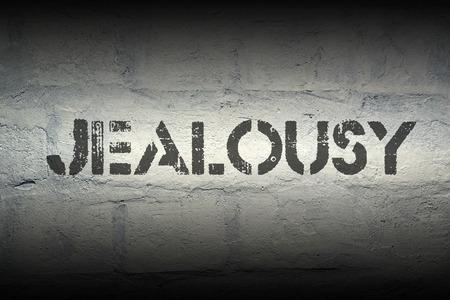 celos: impresi�n de la plantilla los celos en la pared de ladrillo blanco de grunge