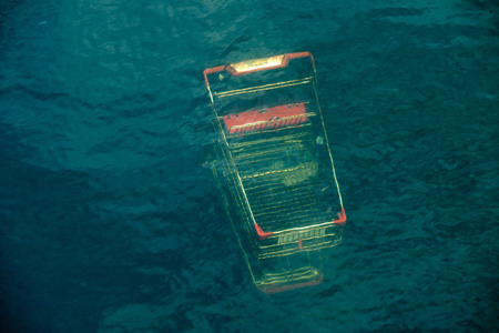 drowned: big shopping trolley under waters of city river Stock Photo