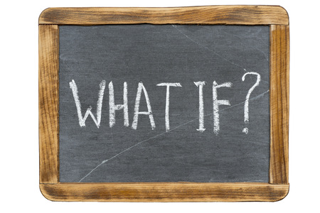 what if: what if question handwritten on vintage slate chalkboard isolated on white Stock Photo