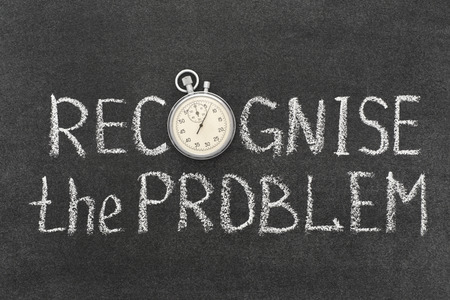 recognize: recognise the problem concept handwritten on chalkboard with vintage precise stopwatch used instead of O