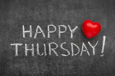thursday: happy Thursday phrase handwritten on blackboard with heart symbol instead of O