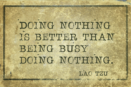 lao: Doing nothing is better than  - ancient Chinese philosopher Lao Tzu quote printed on grunge vintage cardboard Stock Photo