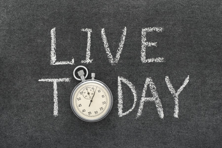 precise: live today concept handwritten on chalkboard with vintage precise stopwatch used instead of O
