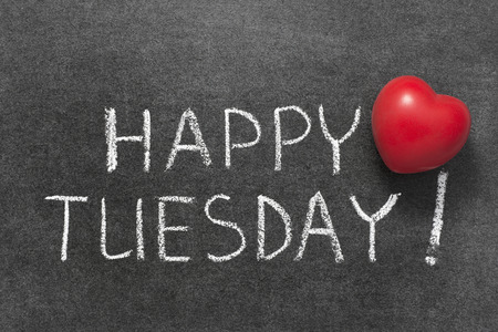 happy Tuesday phrase handwritten on blackboard with red heart symbol