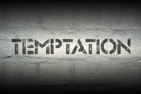 temptation: temptation stencil print on the grunge white brick wall Stock Photo