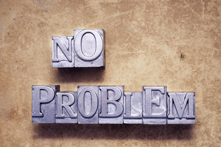negation: no problem phrase made from vintage metallic letterpress type