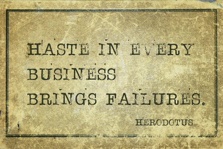 historian: Haste in every business brings failures - ancient Greek historian Herodotus quote printed on grunge vintage cardboard Stock Photo