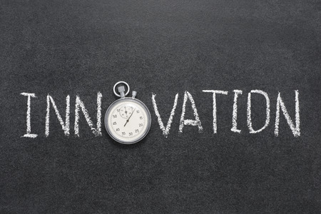 innovation word: innovation word handwritten on chalkboard with vintage precise stopwatch used instead of O Stock Photo