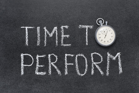 perform: time to perform phrase handwritten on chalkboard with vintage precise stopwatch used instead of O