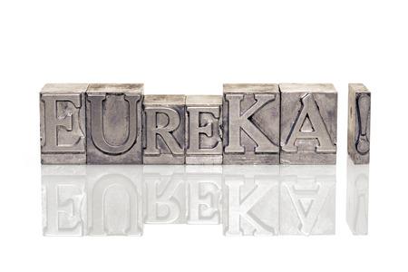 eureka: eureka exclamation made from metallic letterpress type on reflective surface Stock Photo
