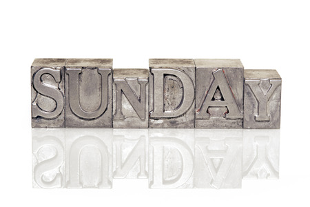 reflective: Sunday word made from metallic letterpress type on reflective surface