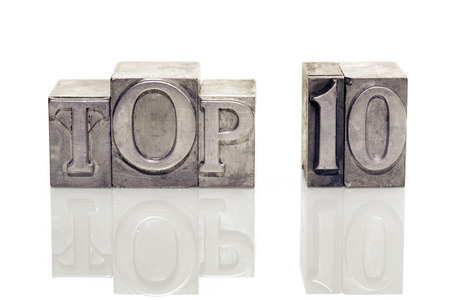 top ten: top ten phrase made from metallic letterpress type on reflective surface
