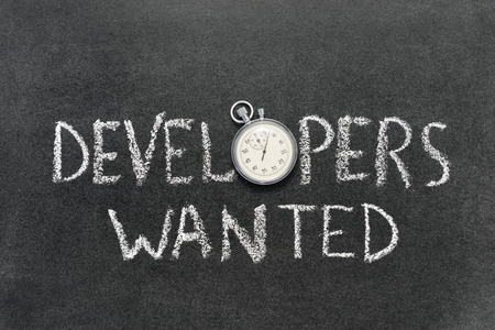 developers: developers wanted phrase handwritten on chalkboard with vintage precise stopwatch used instead of O Stock Photo
