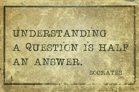 ancient philosophy: understanding a question is half an answer - ancient Greek philosopher Socrates quote printed on grunge vintage cardboard