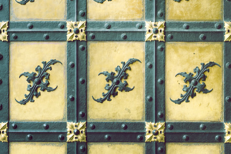 neues: detailed fragment of ancient door decoration of famous Neues Rathaus New City Hall building in Munich, Germany