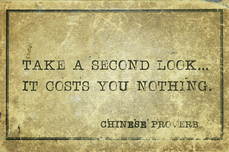 proverb: Take a second look - ancient Chinese proverb printed on grunge vintage cardboard