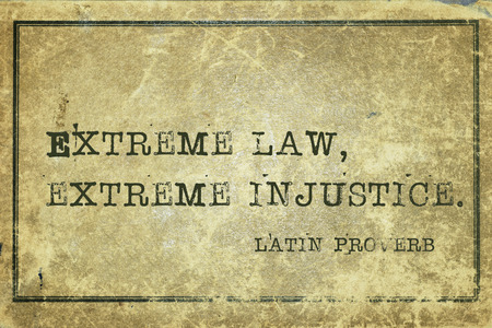 injustice: Extreme law, extreme injustice - ancient Latin proverb printed on grunge vintage cardboard