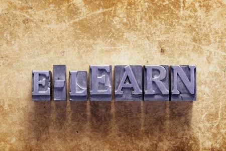 elearn: e-learn word made from metallic letterpress type on vintage cardboard