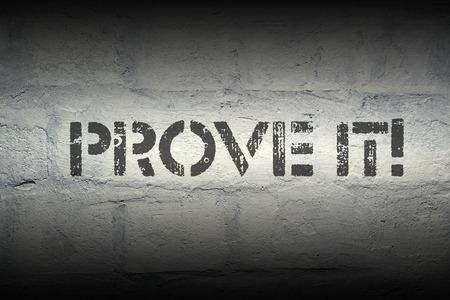 prove: prove it stencil print on the grunge white brick wall