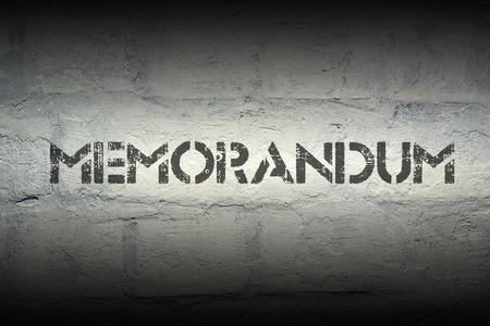 memorandum: memorandum stencil print on the grunge white brick wall