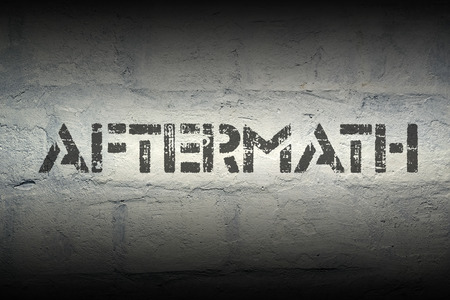 aftermath: aftermath stencil print on the grunge white brick wall