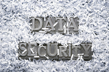 data security phrase made from metallic letterpress type inside of shredded paper heap Stock Photo