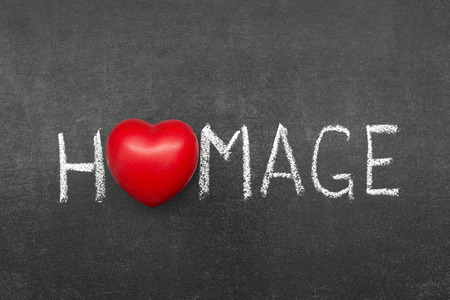 homage: homage word handwritten on chalkboard with heart symbol instead of O