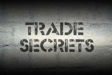 trade secret: trade secret stencil print on the grunge white brick wall