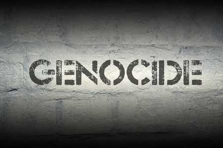genocide: genocide stencil print on the grunge white brick wall Stock Photo