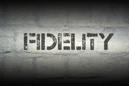 trait: fidelity stencil print on the grunge white brick wall