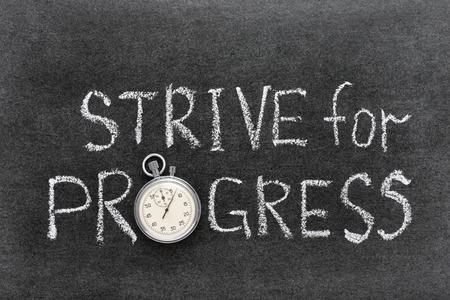 strive: strive for progress phrase handwritten on chalkboard with vintage precise stopwatch used instead of O
